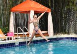 Jennifer Nicole Lee in a fun tiger-print one-piece poolside
