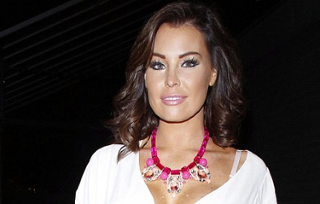 Jessica Wright into an unusual tie-up swimsuit