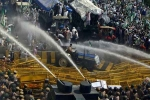 Police Opened Tear Gas and Water Cannons To Control The Outraging Farmers At Delhi Border